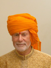 dastar(0.0), hat(0.0), cap(0.0), art(1.0), orange(1.0), face(1.0), clothing(1.0), yellow(1.0), head(1.0), turban(1.0), headgear(1.0),