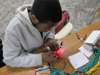 Elishah installing the LEDs in his sign