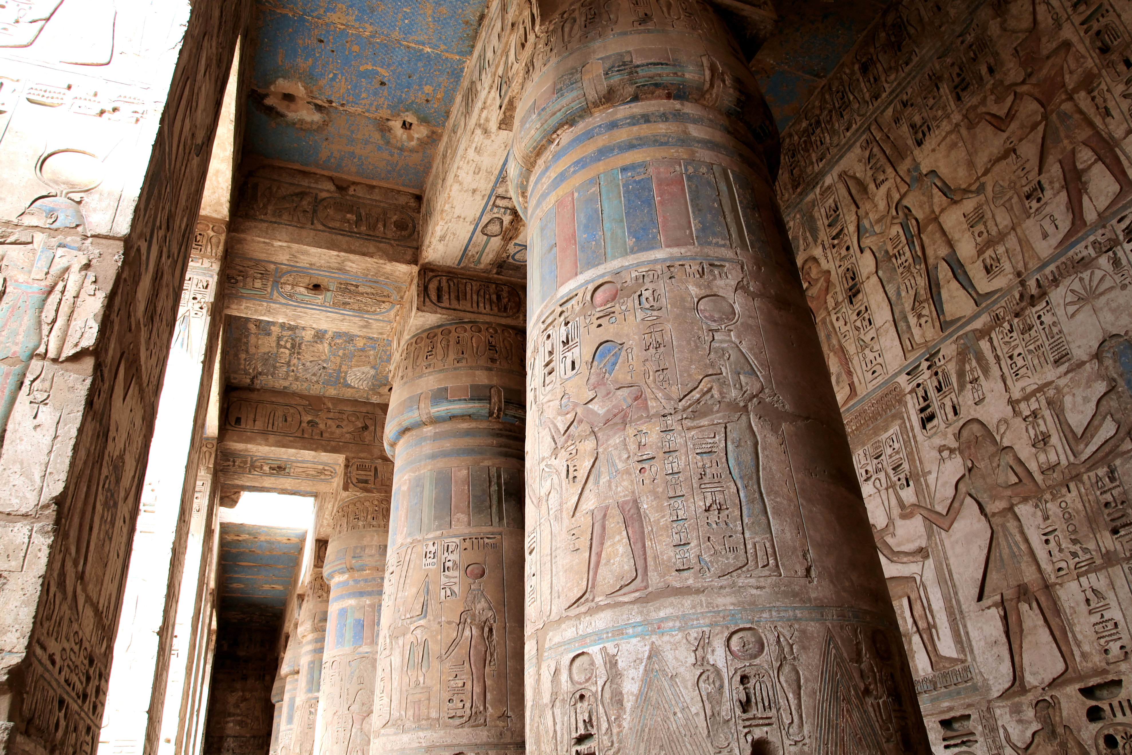 Beautifully decorated columns in medinet habu temple for Architecture design company in egypt
