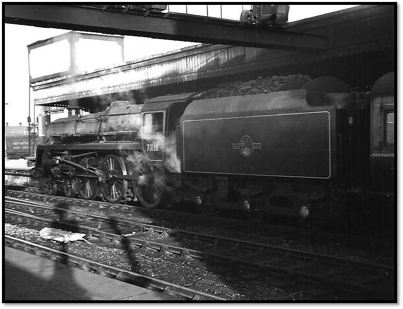 73138 waits to depart from Platform 12 on Thursday March 26 1964