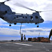 Sea Knight helicopter transfers ordnance from USS Boxer