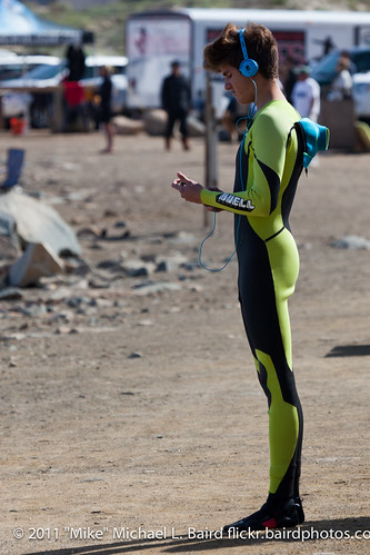 "Young thin male youth surfer at the ready on land at the WSA ""The Rock"" Surfing Contest, Morro Bay, CA 05 March 2011"