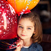 Happy girl with 4 year old birthday balloons by Rebecca812