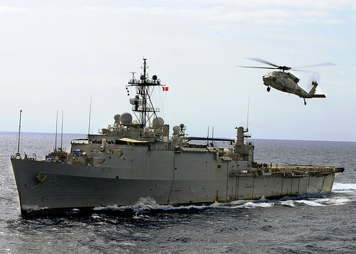 Helicopter flies above USS Ponce.