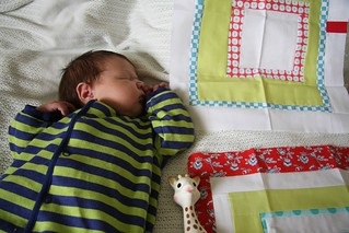 Baby Eleanor with Red & Aqua Bee blocks