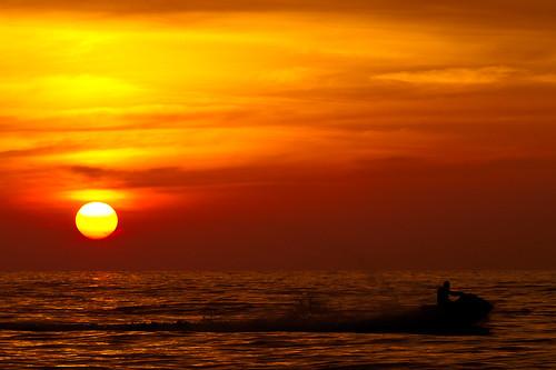 sunset sea sky orange sun beach ball golden hour midway jetski initao