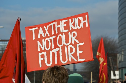 Tax the rich, not our future placard