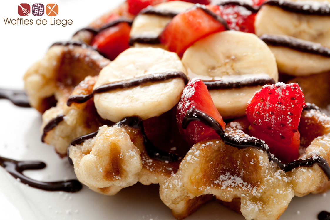 Liege waffle w/ fruit toppings and chocolate syrup ...