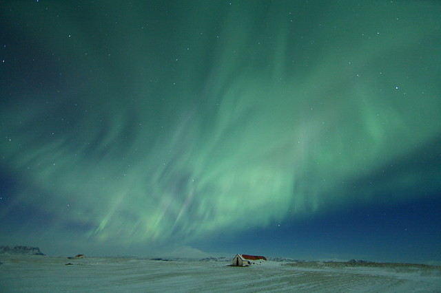 House Under Northern Lights in Iceland