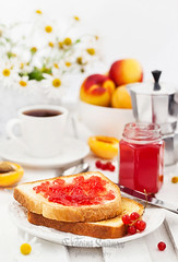 Fresh toasts with jelly, cup of coffee and fruits…