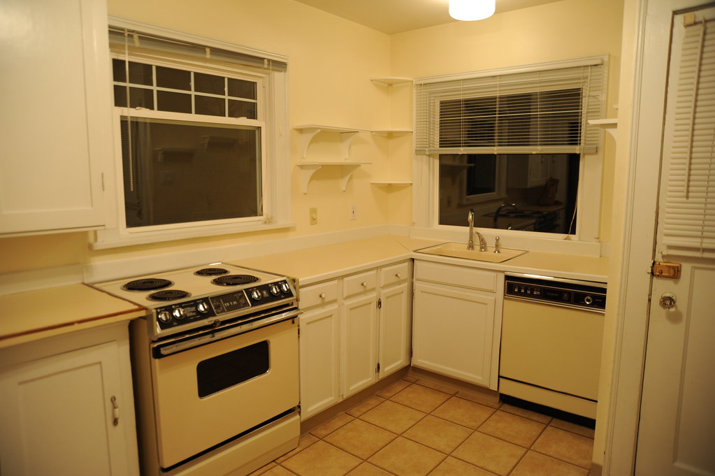 Rental House Kitchen, Yellow Walls, Yellow Fixtures And Appliances, Yellow  Tile Floor,
