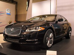 performance car(0.0), automobile(1.0), automotive exterior(1.0), executive car(1.0), wheel(1.0), vehicle(1.0), automotive design(1.0), auto show(1.0), bumper(1.0), jaguar xf(1.0), sedan(1.0), personal luxury car(1.0), land vehicle(1.0), luxury vehicle(1.0),