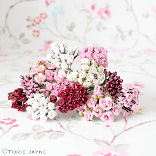 Small decorative paper flowers
