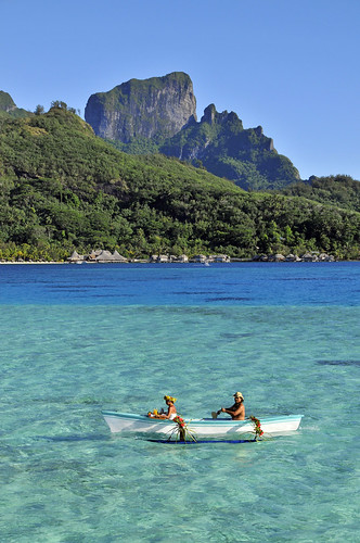 Breakfast delivery by outrigger canoe at the InterContinental Bora Bora Le Moana Resort