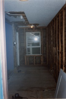 The hallway being prepared to be joined to the bedroom