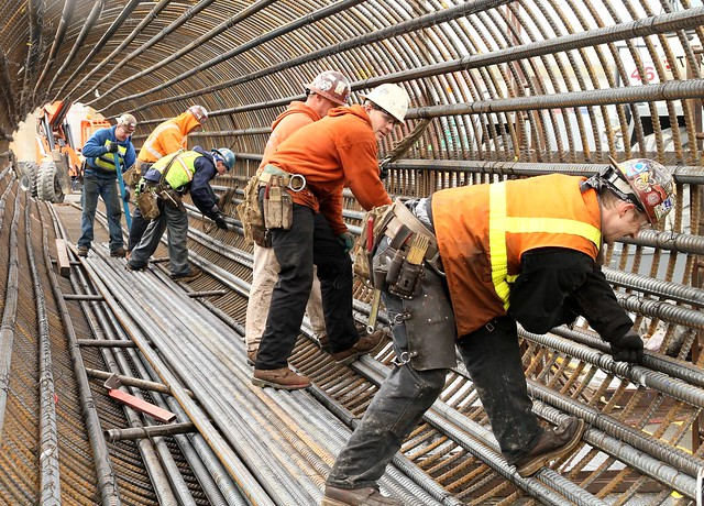 steel workers forming a rebar cage