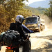Pete & Natasha Motorcycling on Dirt Road