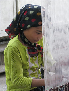 Young girl learning to weave carpets - Hotan, Xinjiang | by retrotraveller
