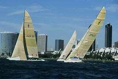 The fleet of International America's Cup Class boats sailed exhibition races in San Diego Bay to highlight the 1995 America's Cup event held offshore of Point Loma in the Pacific Ocean.