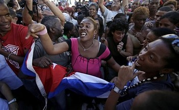 Supporters of Cuba's government chant revolutionary slogans as they argue with members of the Cuban dissident group 'Ladies in White' in Havana, Cuba, Wednesday, Feb. 23, 2011.  by Pan-African News Wire File Photos