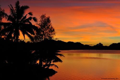 sunset sea island coast pacific palau micronesia