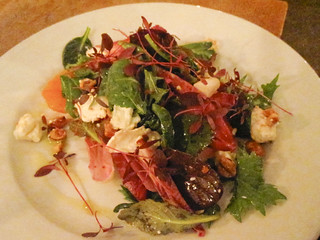 Red chicory, goat's cheese and blood orange salad with hazelnut dressing