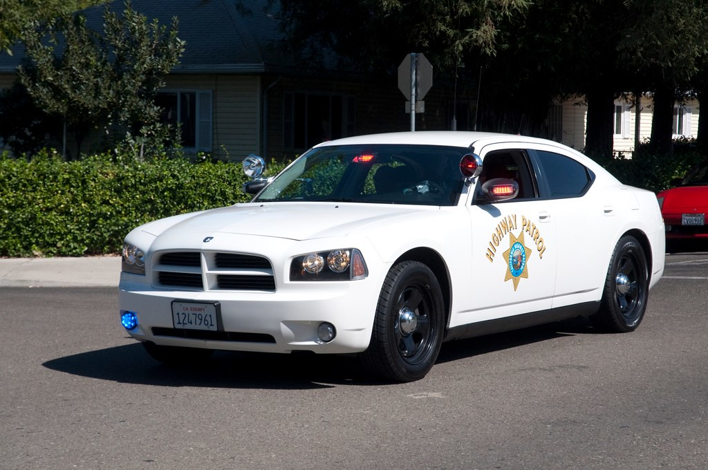 California Highway Patrol Dodge Charger Driving A Photo
