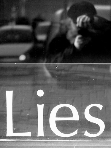 "A couple cheating in the background, with the words ""Lies"" written on the front"