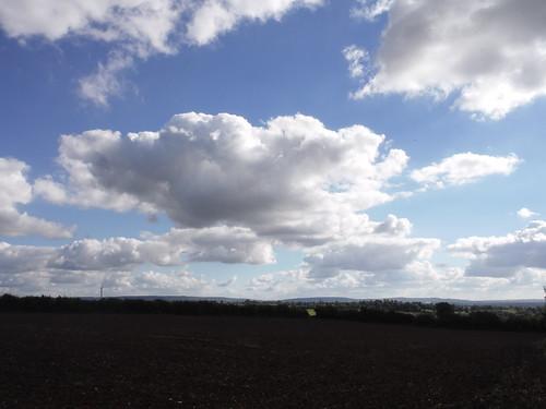 Cloudscape over large arable field, towards Aston Abbotts