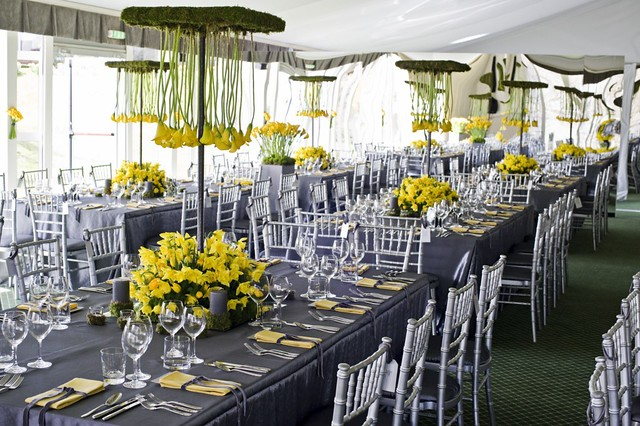 Our silver taffeta tablecloths complement the striking yellow of the flowers