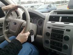 rim(0.0), automobile(1.0), automotive exterior(1.0), wheel(1.0), vehicle(1.0), ford escape(1.0), steering wheel(1.0), bumper(1.0), ford(1.0), land vehicle(1.0),