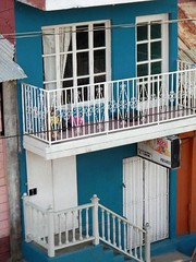 outdoor structure(0.0), furniture(0.0), cage(0.0), porch(0.0), bed(0.0), dollhouse(0.0), baluster(1.0), handrail(1.0), property(1.0), facade(1.0), stairs(1.0), balcony(1.0),