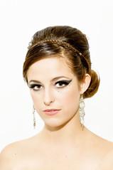 bride(0.0), black hair(0.0), gown(0.0), face(1.0), hairstyle(1.0), model(1.0), chignon(1.0), bun(1.0), head(1.0), hair(1.0), eyelash(1.0), fashion(1.0), photo shoot(1.0), brown hair(1.0), eyebrow(1.0), beauty(1.0), eye(1.0),