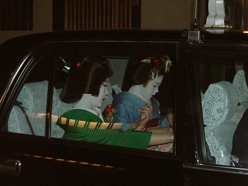 Geiko Koemi (?) and maiko Kogiku in a taxi