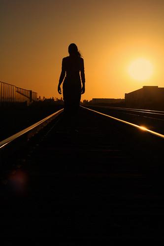 railroad sunset orange sun girl silhouette walking tracks silhouettes orangesky railroadtracks
