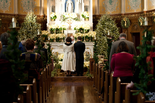Bride and groom at altar Photo by James Reyes Photography