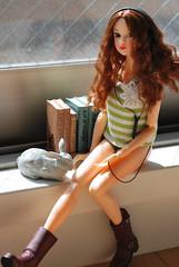 stocking(0.0), adult(0.0), clothing(1.0), hair(1.0), limb(1.0), leg(1.0), photo shoot(1.0), lady(1.0), long hair(1.0), human body(1.0), brown hair(1.0), blond(1.0), thigh(1.0), sitting(1.0), toy(1.0),