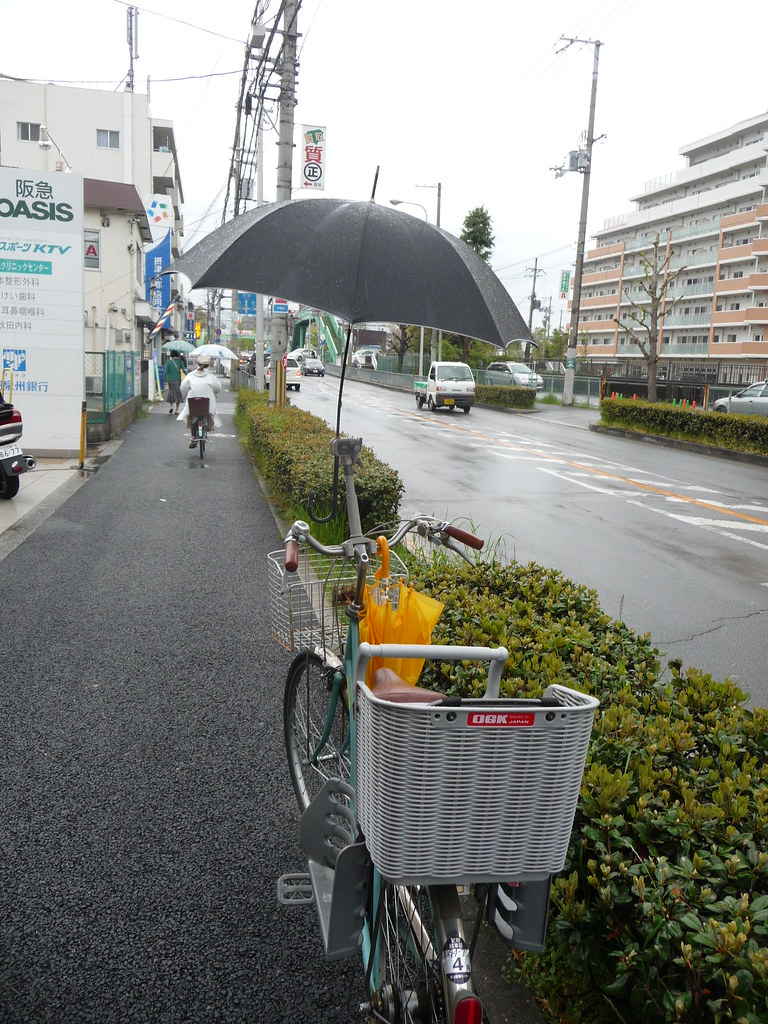 A bicycle with its umbrella