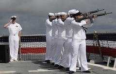 PEARL HARBOR (April 14, 2011) Sailors from USS Chung-Hoon's (DDG 93) ceremonial guard perform a 21-gun salute during the USS Sigsbee remembrance ceremony aboard the ship's flight deck. (U.S. Navy photo by Mass Communication Specialist 2nd Class Robert Stirrup)