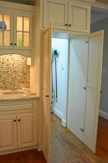After addition remodel hidden walk in pantry explore for Hidden pantry doors
