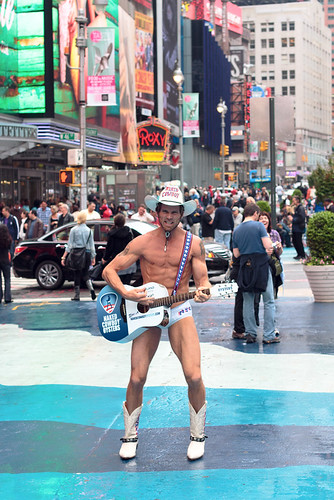 Naked Cowboy continues to busk in Times Square amid
