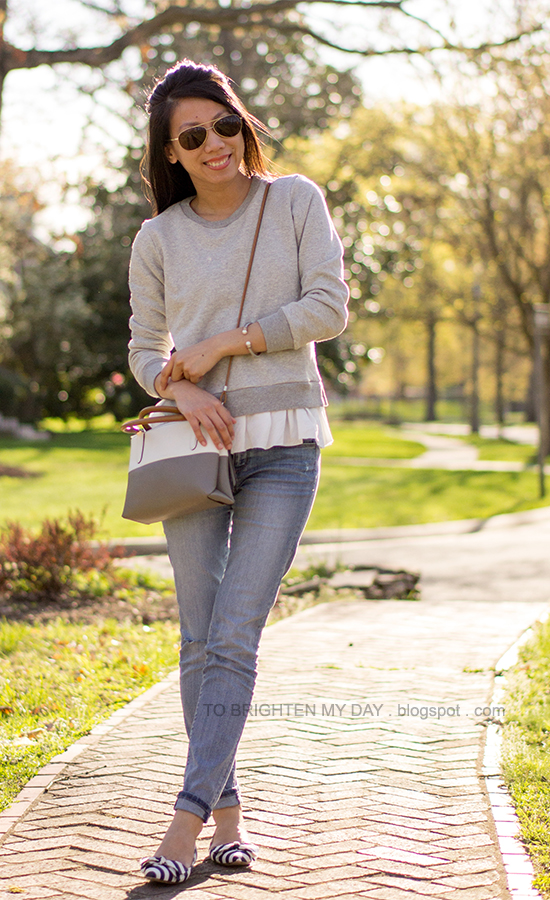 ruffled gray sweatshirt, light wash jeans, crossbody bag, striped flats