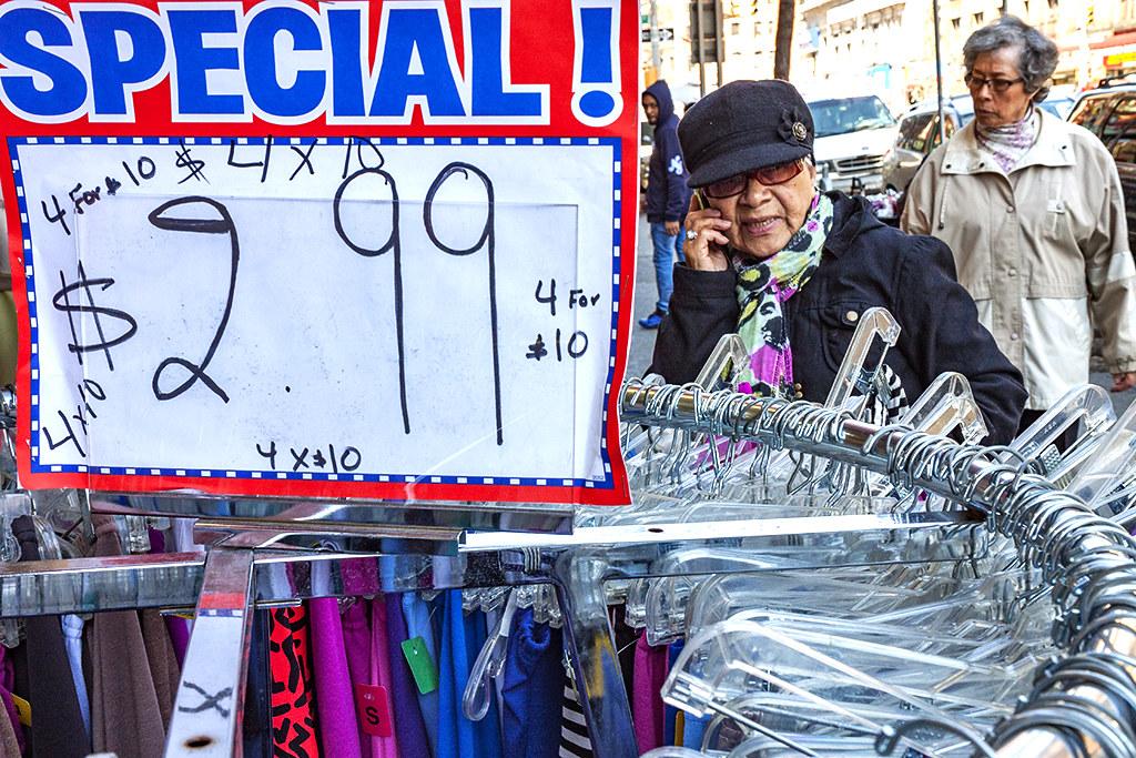 Clothing-rack-on-sidewalk-on-4-24-14--Washington-Heights