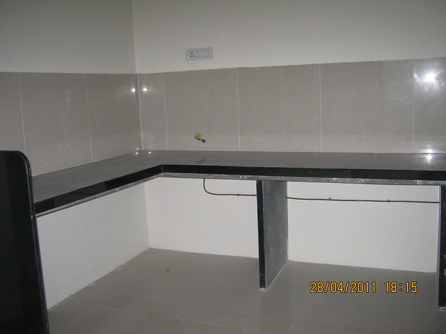 L Shaped Kitchen Platform With Jet Black Granite Top And Piped Gas Connection In A Flat At