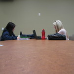 Two female students take advantage of our wonderfully spacious study tables and super-fast wi-fi! Karen H. Huntsman Library, Snow College, Ephraim, Utah.