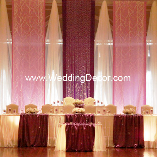 A royal purple lavender and white wedding backdrop with matching head table