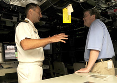 JOINT BASE PEARL HARBOR-HICKAM, Hawaii (April 19, 2011) Cmdr. Bob Roncska, commanding officer of the Virginia-class submarine USS Texas (SSN 775) explains the basic submarine controls and operations to the Honorable John Culberson, Texas Congressman, during a tour of USS Texas. (U.S. Navy photo by Mass Communication Specialist 2nd Class Ronald Gutridge)