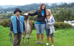 Students standing with a llama in Equador