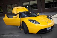 tesla(0.0), automobile(1.0), tesla roadster(1.0), vehicle(1.0), automotive design(1.0), land vehicle(1.0), supercar(1.0), sports car(1.0),