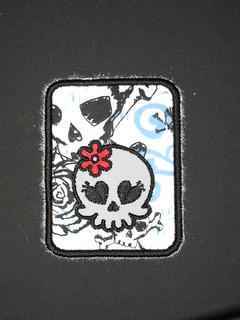 luggage tag with sweetie skully patch